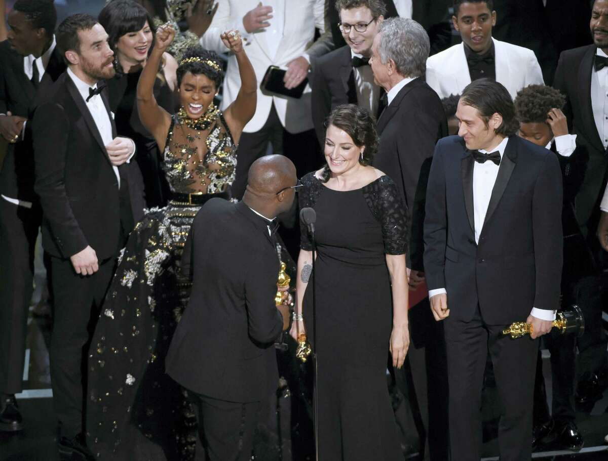 """Janelle Monae reacts as the cast and crew accept the award for best picture for """"Moonlight"""" at the Oscars on Sunday at the Dolby Theatre in Los Angeles."""