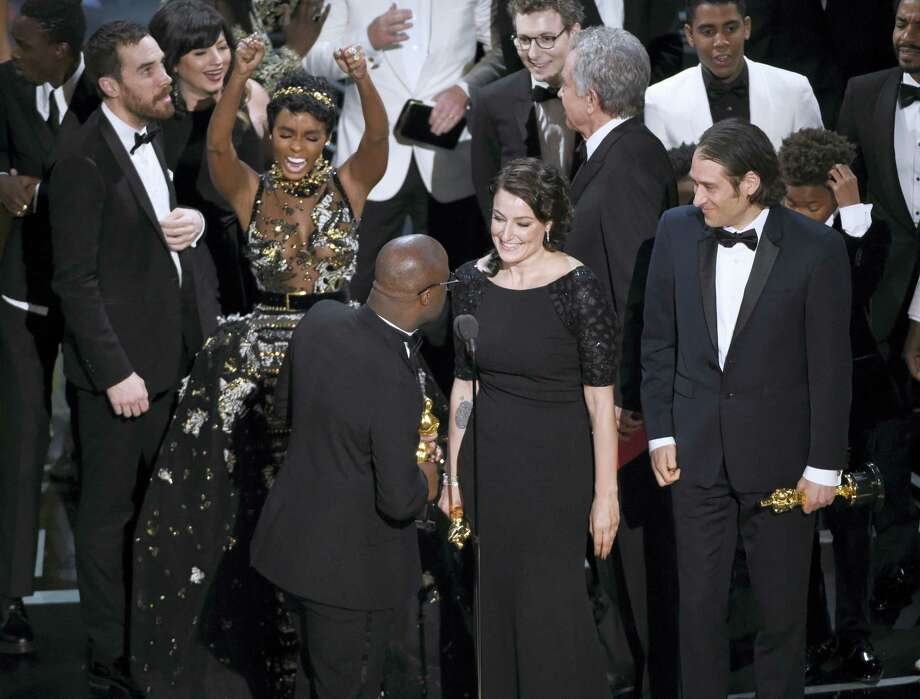 """Janelle Monae reacts as the cast and crew accept the award for best picture for """"Moonlight"""" at the Oscars on Sunday at the Dolby Theatre in Los Angeles. Photo: Photo By Chris Pizzello — Invision — AP   / 2017 Invision"""
