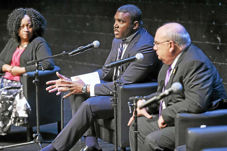 From left, Berta Holmes, Project Longevity New Haven social services coordinator; Brent Peterkin, Project Longevity statewide coordinator; and New Haven Police Department Assistant Chief Achilles Generoso discuss community policing and Project Longevity during a discussion Wednesday at Long Wharf Theatre in New Haven. Photo: Peter Hvizdak — New Haven Register   / ?2017 Peter Hvizdak