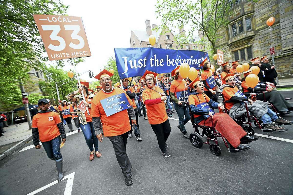 Protestors with Local 33 and other union members march up Elm Street before the start of Yale University Commencement on Old Campus in New Haven May 22 protesting the university's failure to negotiate with the graduate student union.