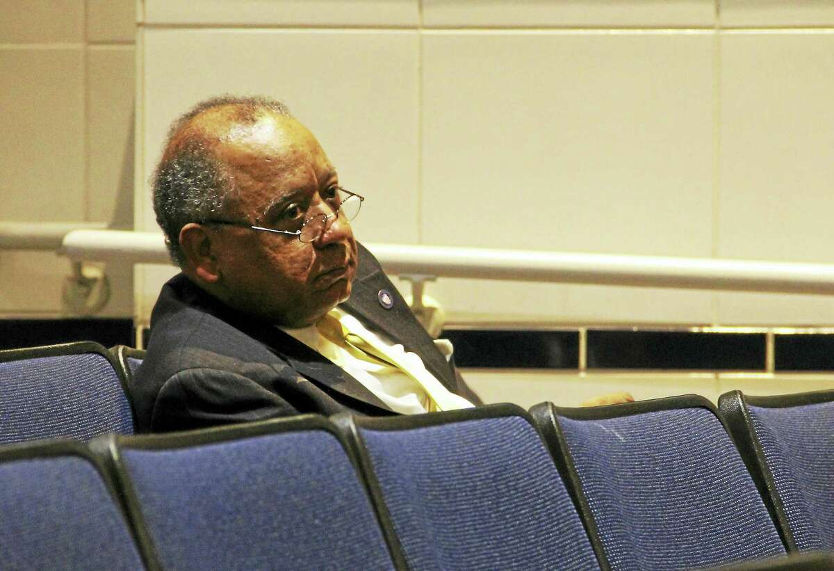New Haven Chief Administrative Officer Michael Carter watches Thursday's public hearing at James Hillhouse High School.