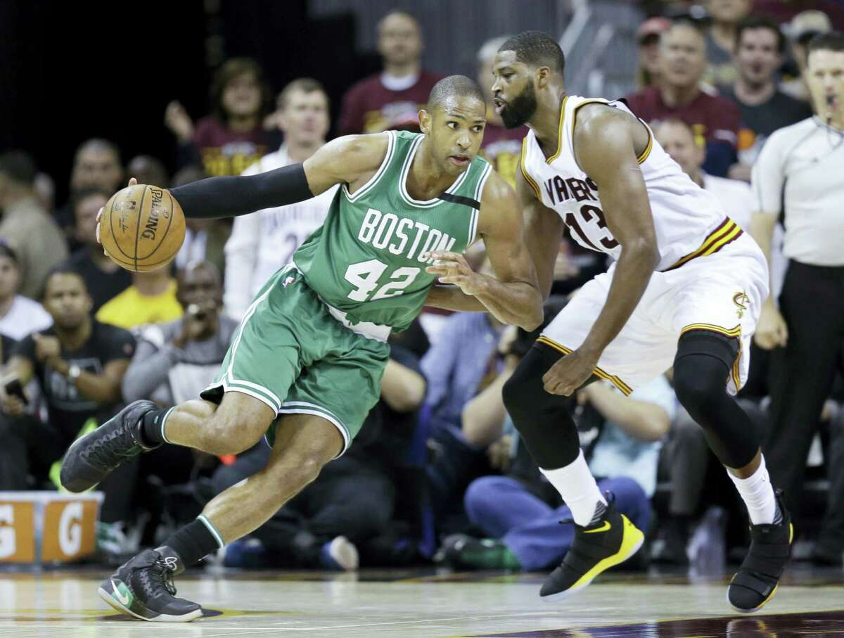 Boston Celtics' Al Horford (42) drives on Cleveland Cavaliers' Tristan Thompson (13) during the second half of Game 4 of the NBA basketball Eastern Conference finals, Tuesday, in Cleveland.