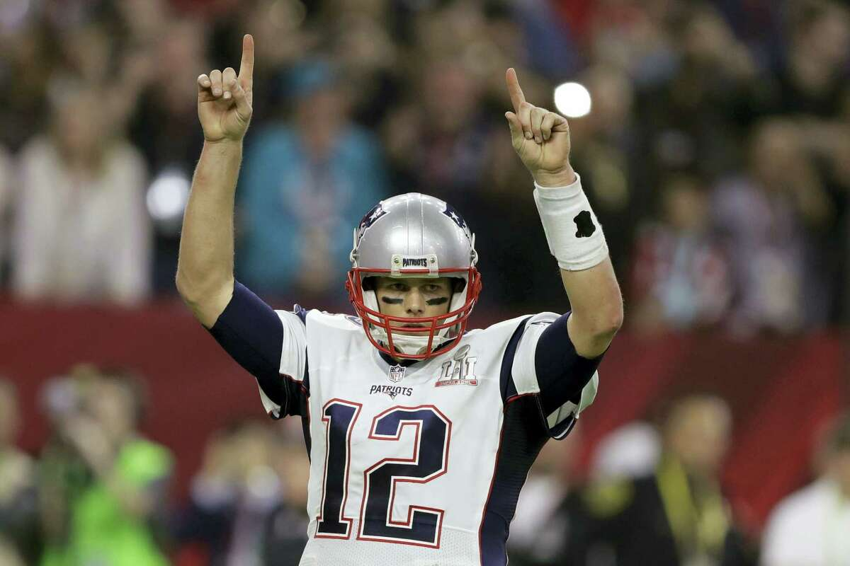 New England Patriots player Tom Brady raises his arms after a touchdown, during the second half of the NFL Super Bowl 51 football game against the Atlanta Falcons Feb. 5 in Houston.