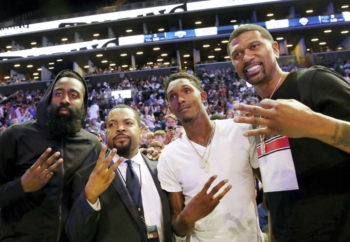 From left, Houston Rockets guard James Harden, poses for a photograph with league founder Ice Cube, Rockets Lou Williams and ESPN analyst and former basketball player Jalen Rose at the Barclays Center in New York.