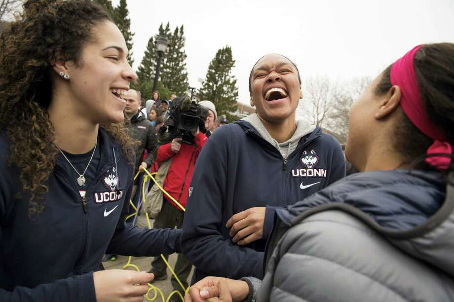 MARK MIRKO — NARTFORD COURANT VIA AP  UConn women's  basketball players, from left, Kia Nurse, Azura Stevens and Napheesa Collier share a laugh outside Gampel Pavilion in Storrs Tuesday as they prepare to board a bus to depart for the Final Four in Dallas. UConn's Natalie Butler, rear left, follows. Photo: AP / ©2017 The Hartford Courant