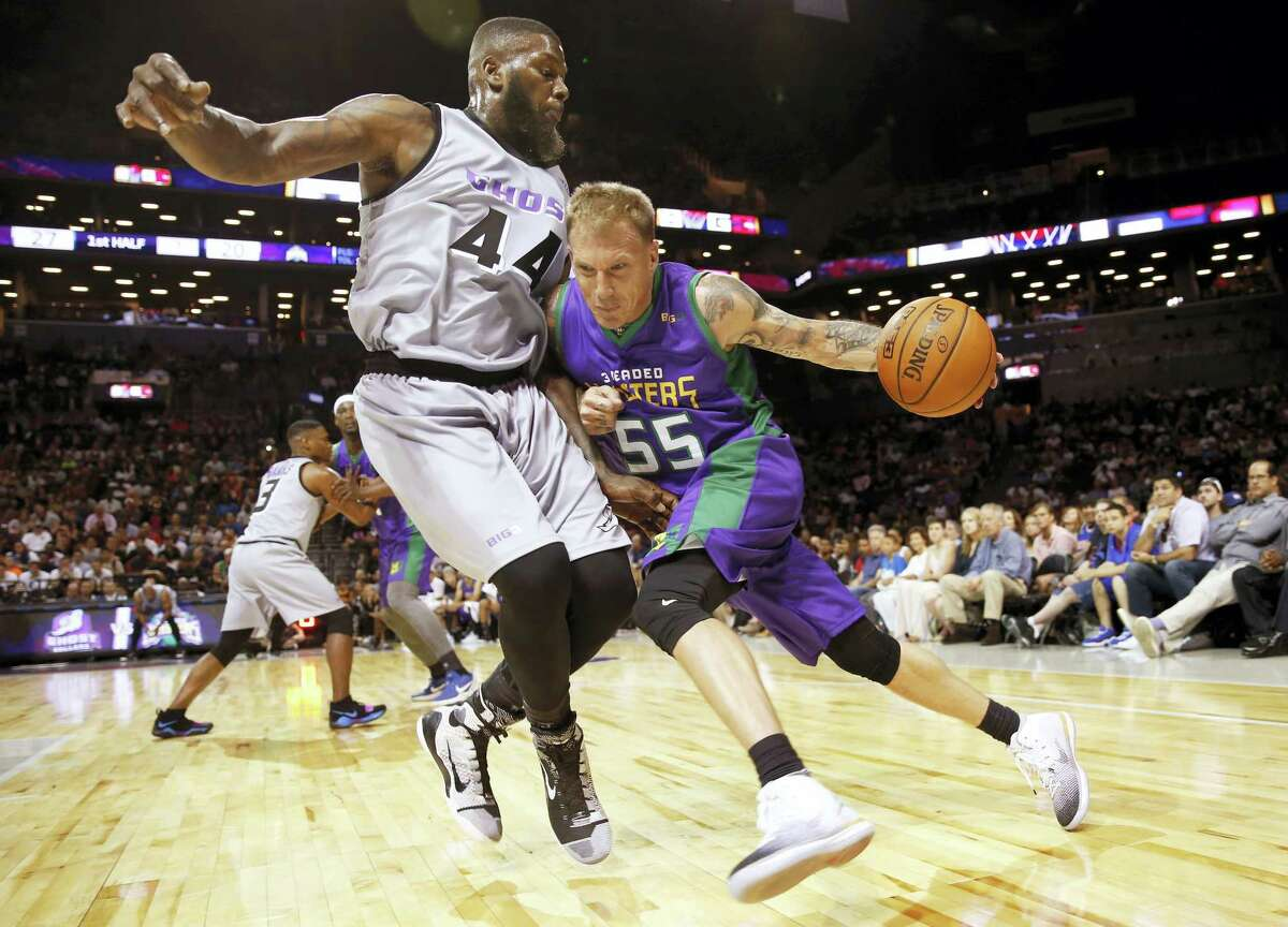 3 Headed Monsters' Jason Williams (55) drives against Ghost Ballers' Ivan Johnson during the first half of Game 1 in the BIG3 Basketball League debut on Sunday.