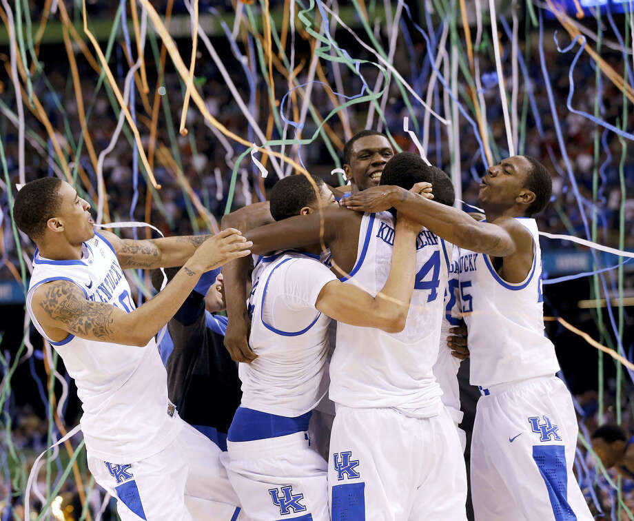 In this April 2, 2012, file photo, Kentucky players celebrate ITS NATIONAL CHAMPIONSHIP against Kansas. The Associated Press is ranking the top 100 college basketball programs of all time using 68 years of data from the AP Top 25 poll. Photo: ASSOCIATED PRESS FILE PHOTO   / Copyright 2017 The Associated Press. All rights reserved.