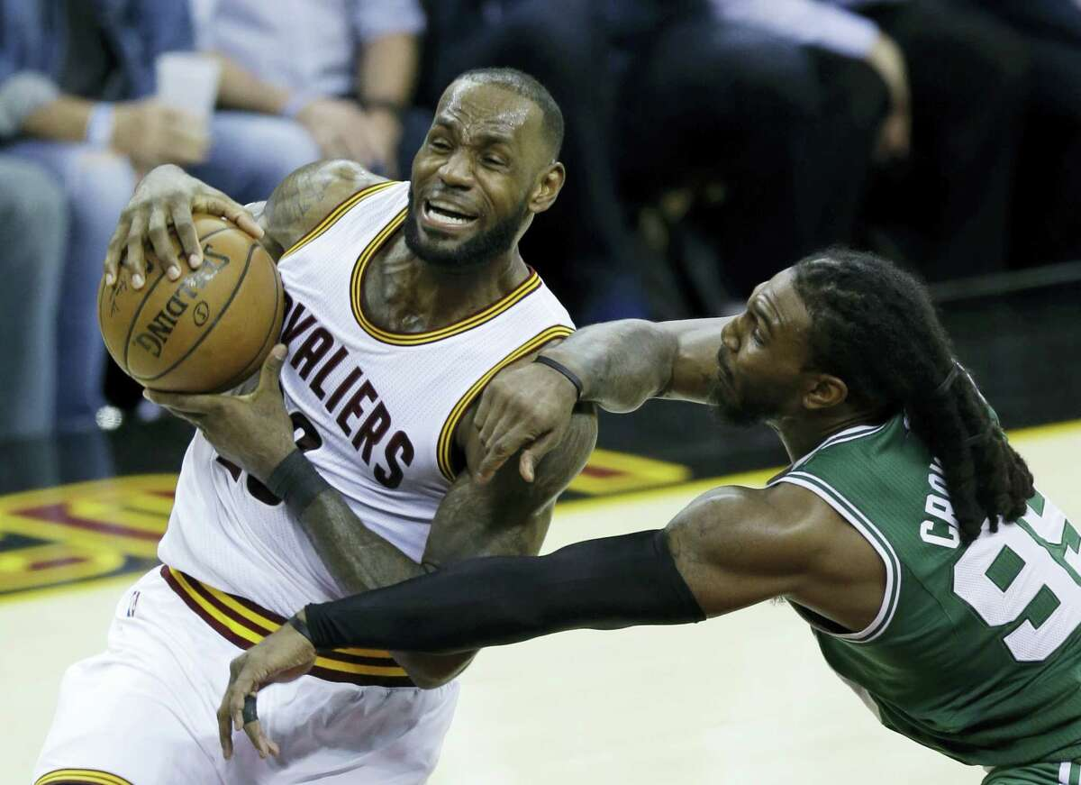 The Cavaliers' LeBron James (23) goes up for a shot against the Celtics' Jae Crowder.