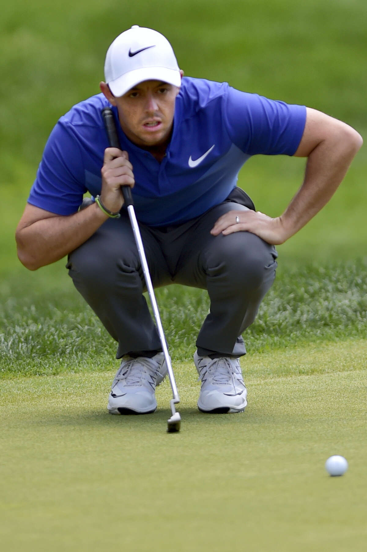 Rory McIlroy lines a putt up on the 18th green during the final round of the Travelers Championship Sunday in Cromwell.