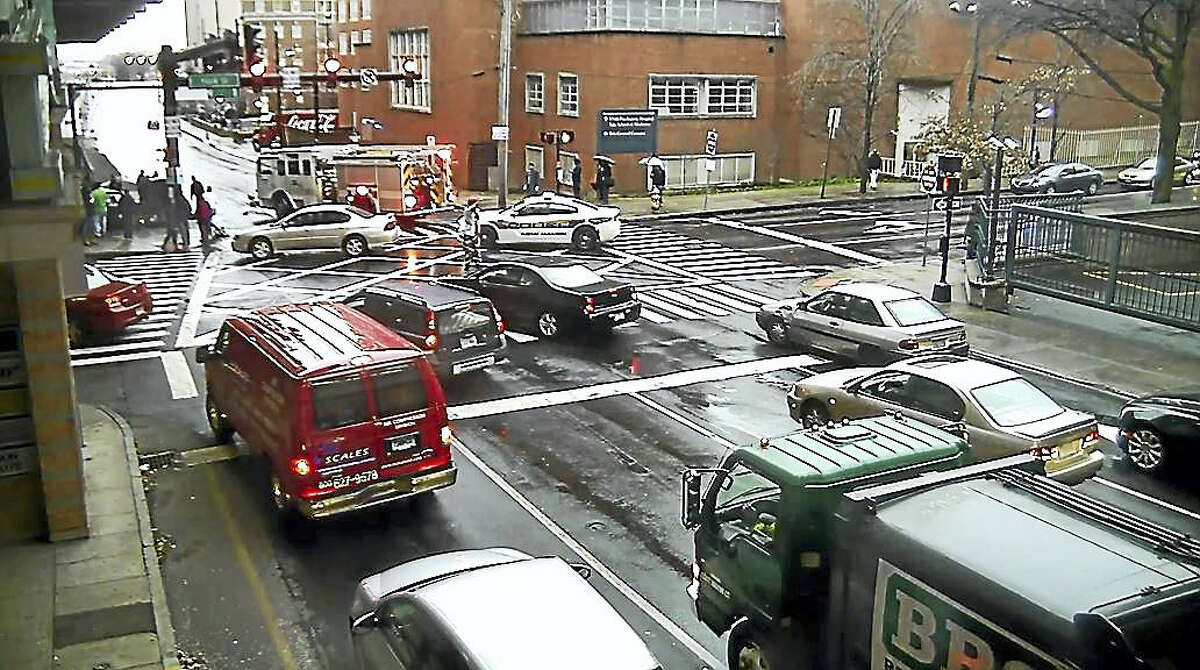 A screengrab from the Jan. 17 city surveillance video shows emergency vehicles at the scene of a fatal car crash at South Frontage Road and York Street in New Haven.