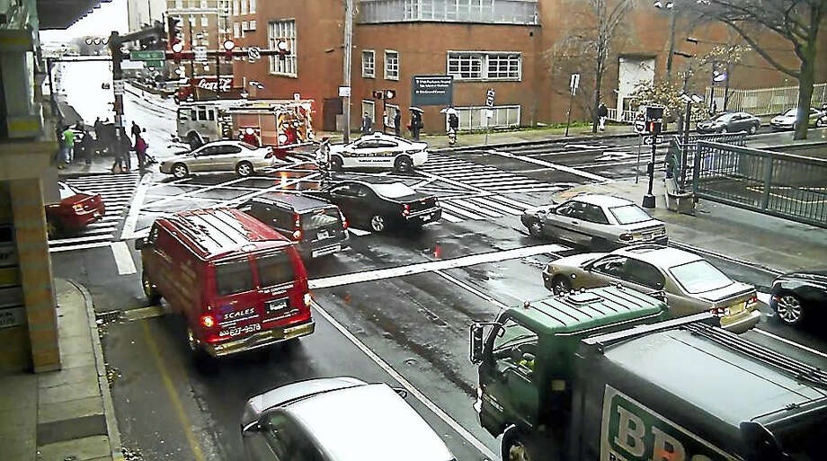 A screengrab from the Jan. 17 city surveillance video shows emergency vehicles at the scene of a fatal car crash at South Frontage Road and York Street in New Haven. Photo: Digital First Media