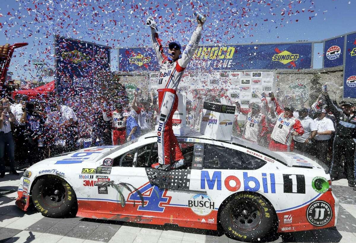 Kevin Harvick celebrates after winning Sunday at Sonoma Raceway.