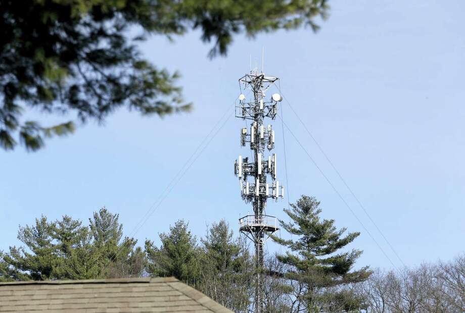 In this photo, a cell tower is seen through trees in North Andover, Mass. Insurance companies are using cellphone tower data to deny claims for stolen cars, burned homes and other mishaps, despite the information coming under question at criminal trials across the country. Photo: Elise Amendola — The Associated Press   / Copyright 2017 The Associated Press. All rights reserved.