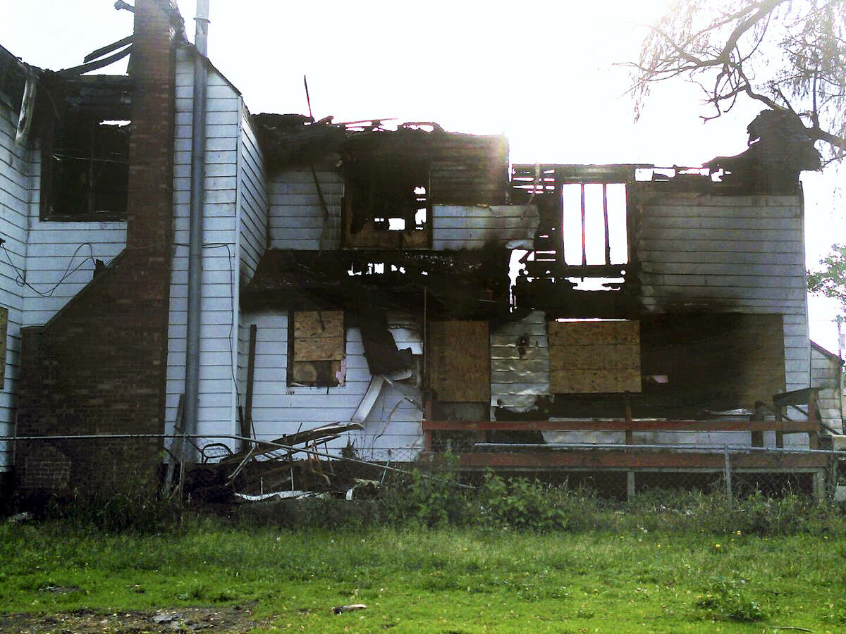 This 2014 photo provided by Jaclyn Bentley' shows the burned remains of her home in Clinton, Iowa. Bentley was acquitted in February 2017 of arson and insurance fraud charges, which she said stemmed from a flawed analysis of cellphone tower records.