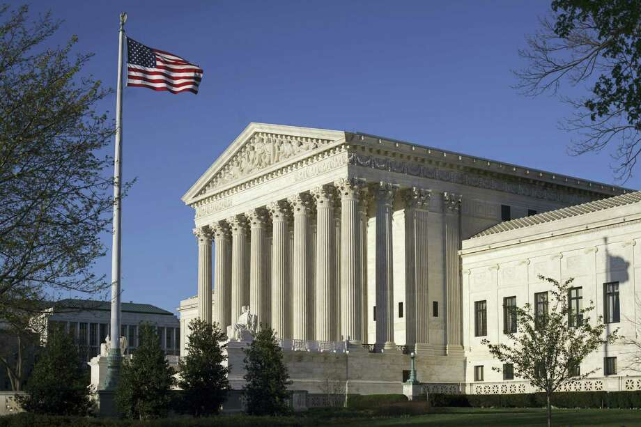 In this photo taken on Tuesday, April 4, 2017, the Supreme Court Building is seen in Washington. The Supreme Court is expected to decide in the next few days whether the Trump administration can enforce a ban on visitors to the United States from six mostly Muslim countries. The legal fight has been going on since President Donald Trump rolled out a ban a week after his inauguration. Photo: AP Photo — J. Scott Applewhite   / Copyright: AP