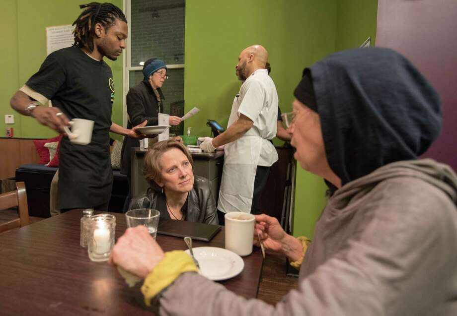 At the EAT Cafe in Philadelphia, owner Mariana Chilton talks with customer Mathilda Jones in the dining room. Photo: Dixie D. Vereen — For The Washington Post   / For The Washington Post