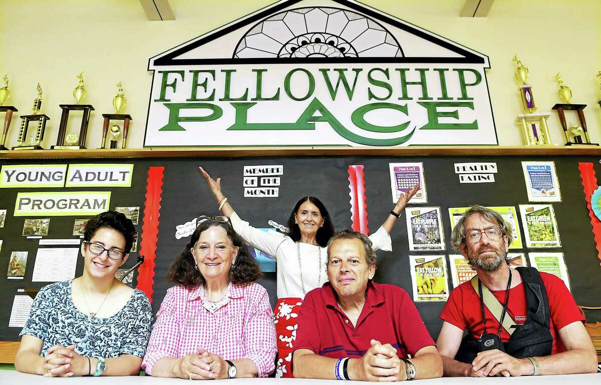 Mary Guerrera, executive director of Fellowship Place in New Haven, rear, with, from left, clients Rina Nimon of New Haven, Beth Stannard of Madison, Charlie Jasinka of New Haven and David Firestone of New Haven.