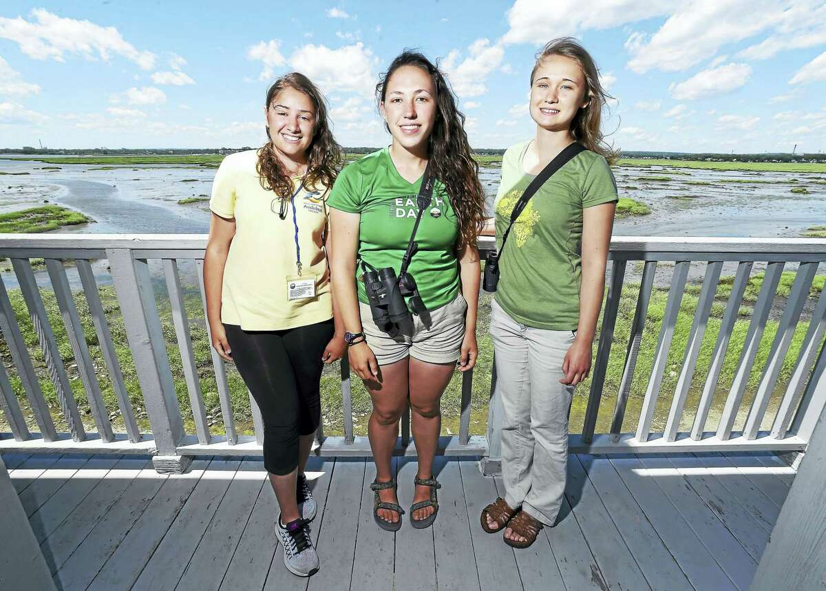 Left to right, Melina Giantomidis, IBA Coastal Ranger, Helena Ives, field technician for the Audubon Alliance for Coastal Water Birds, and Genevieve Nuttall, Osprey Nation Coordinator, are photographed at The Connecticut Audubon Society Coastal Center at Milford Point in Milford.