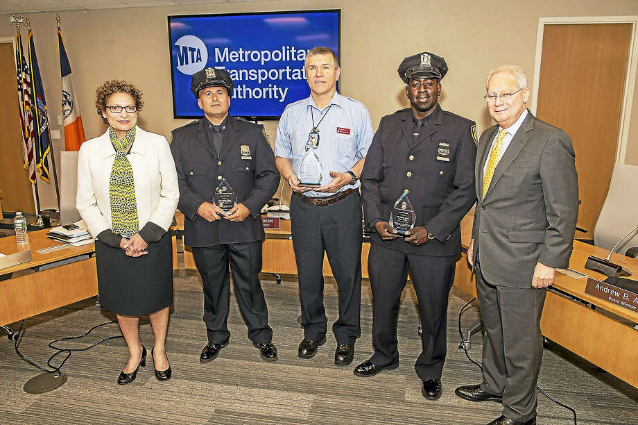 "From left, MTA Interim Executive Director Veronique ""Ronnie"" Hakim, MTA Police Officer Armando Hernandez, Metro-North Railroad Conductor Charles Dolan, MTA Police Officer Desire Bokor and Acting MTA Board Chairman Fernando Ferrer. Photo: CONTRIBUTED PHOTO — Pat Cashin/MTA"