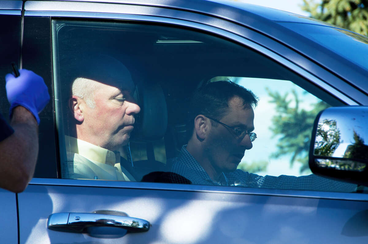 """Republican candidate for Montana's only U.S. House seat, Greg Gianforte, sits in a vehicle near a Discovery Drive building Wednesday, May 24, 2017, in Bozeman, Mont. A reporter said Gianforte """"body-slammed"""" him Wednesday, the day before the special election."""