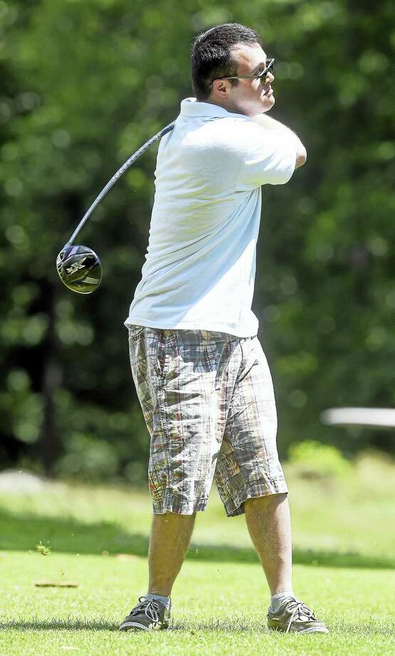 Sean Bogart of Hamden watches his drive on the second hole of the Mia Joseph Golf Tournament at Laurel View Country Club in Hamden on Sunday. The tournament benefits the North Haven Special Olympics and their families. Photo: Arnold Gold / Hearst Connecticut Media