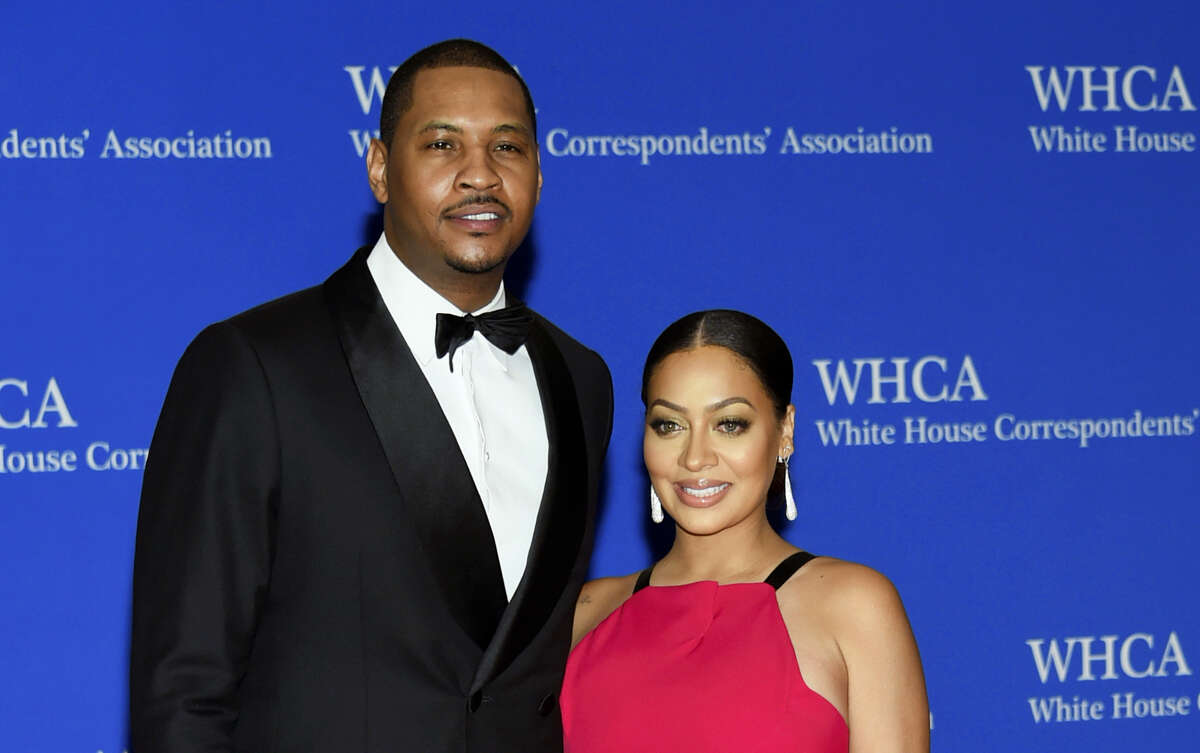 In this April 30, 2016 photo, Carmelo Anthony, left, and La La Anthony arrive at the White House Correspondents' Association Dinner at the Washington Hilton Hotel in Washington. Anthony's concerns go beyond his future with the New York Knicks. The All-Star forward and his wife, actress La La Anthony, are separated, according to a report from TMZ.