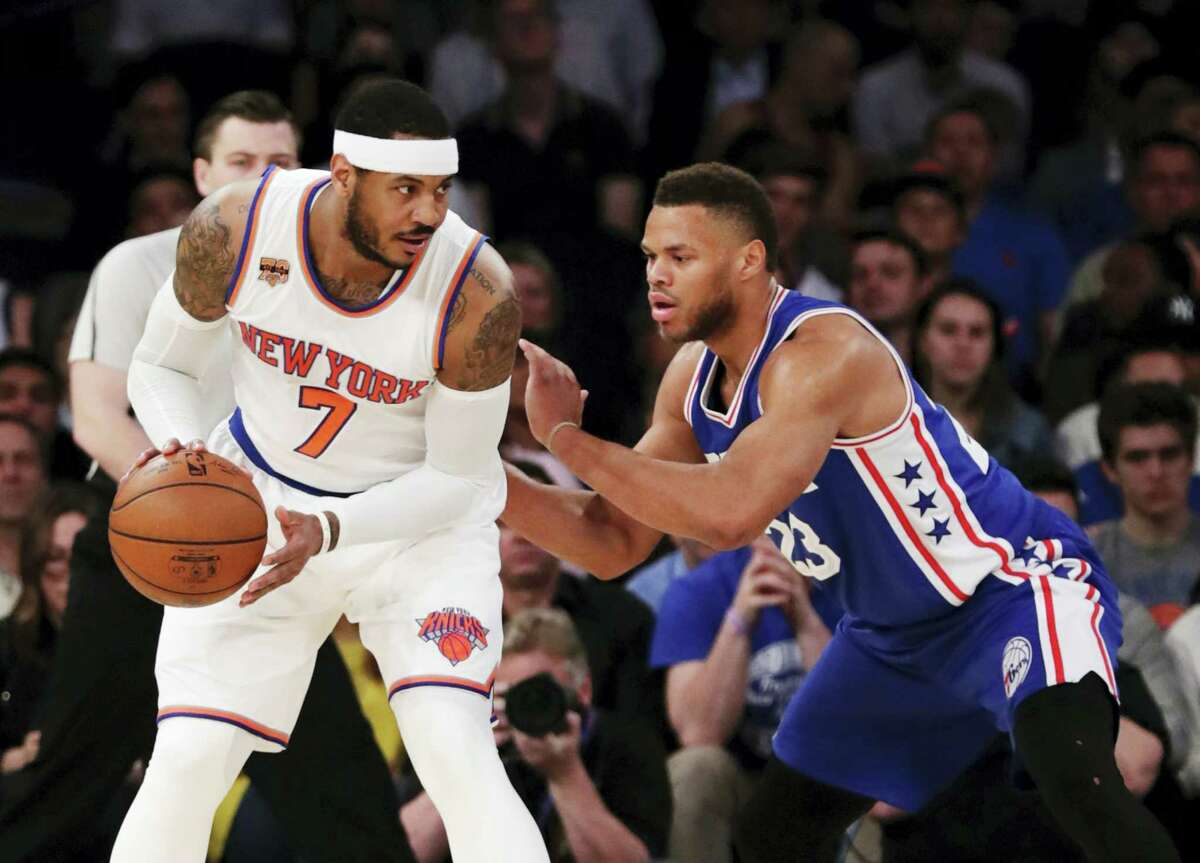 New York Knicks' Carmelo Anthony (7) is defended by Philadelphia 76ers' Justin Anderson (23) during the first half of an NBA basketball game on April 12, 2017 in New York.