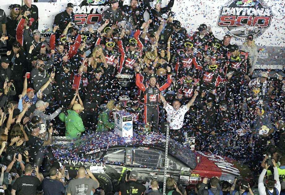 Kurt Busch celebrates with members of his team in Victory Lane after winning the Daytona 500 on Sunday. Photo: Phelan M. Ebenhack — The Associated Press   / FR121174 AP