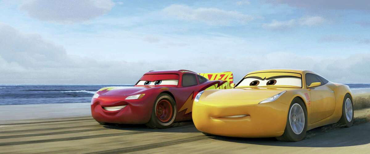 """This image released by Disney shows Lightning McQueen, voiced by Owen Wilson, left, and Cruz Ramirez, voiced by Cristela Alonzo in a scene from """"Cars 3."""" (Disney-Pixar via AP)"""