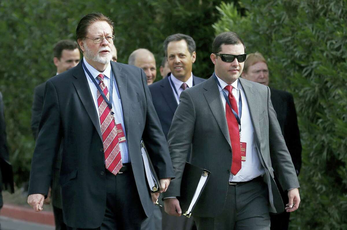 San Francisco 49ers owners John York, left, and Jed York, right, arrive for sessions at the NFL football annual meetings March 27, 2017 in Phoenix. (AP Photo — Ross D. Franklin)