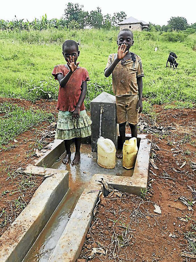 Children collecting water at one of the several pumps in Nganiko. Contributed photo Photo: Digital First Media