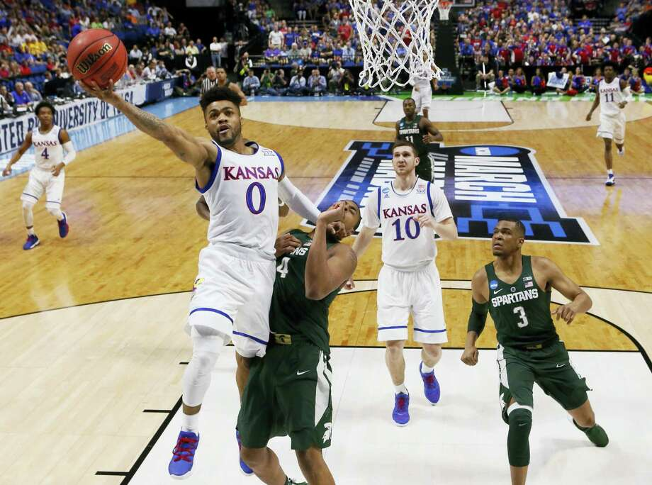 Kansas guard Frank Mason III shoots in front of Michigan State forward Nick Ward (44) and guard Alvin Ellis III (3) during their NCAA Tournament game. Photo: The Associated Press File Photo   / AP2017