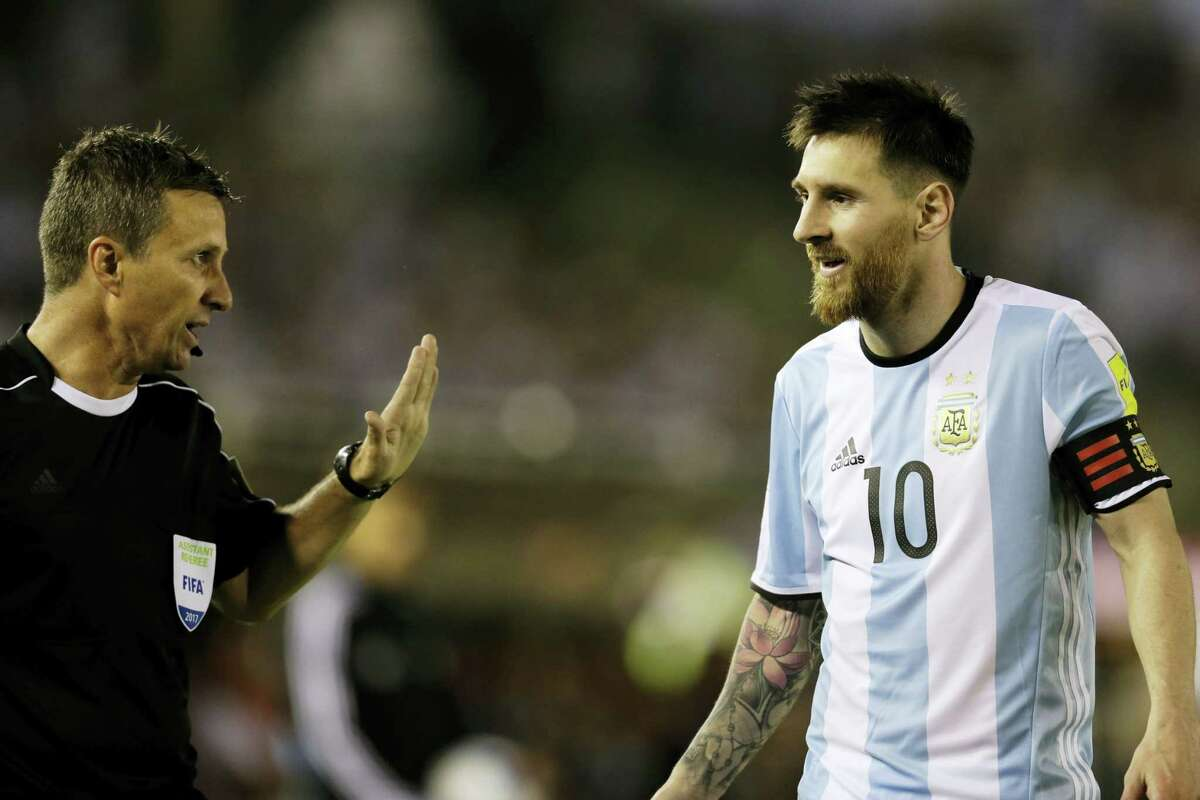 Argentina's Lionel Messi argues with assistant referee Emerson Augusto de Carvalho during a World Cup qualifying match against Chile.