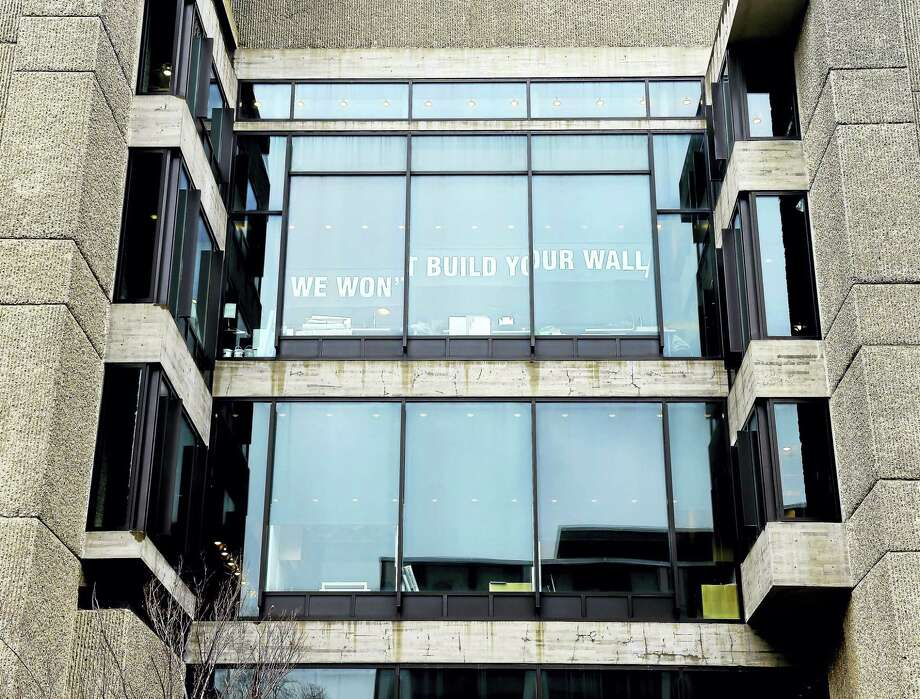 In one example of how area residents are letting their feelings be known since the election, a sign in protest to President Donald Trump's plans for a wall on the border of the United States and Mexico was placed at Yale University's Art and Architecture Building. Photo: Arnold Gold — New Haven Register