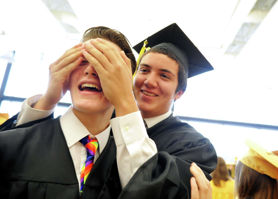 Red Lion Area High School senior Issak Wolfe tries to guess the identity of a friend — fellow senior John Chapman — before the commencement ceremony in 2013. Wolfe, a transgender student, was allowed to wear the boys' black graduation robes, but his legal, female name was read. Photo: CHRIS DUNN — DAILY RECORD/SUNDAY NEWS FILE PHOTO   / Copyrighted