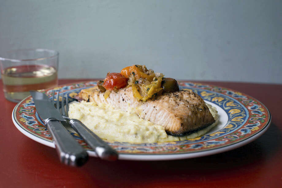 Salmon with polenta and warm tomato vinaigrette. Photo: Sarah Crowder Via AP   / Sarah Crowder