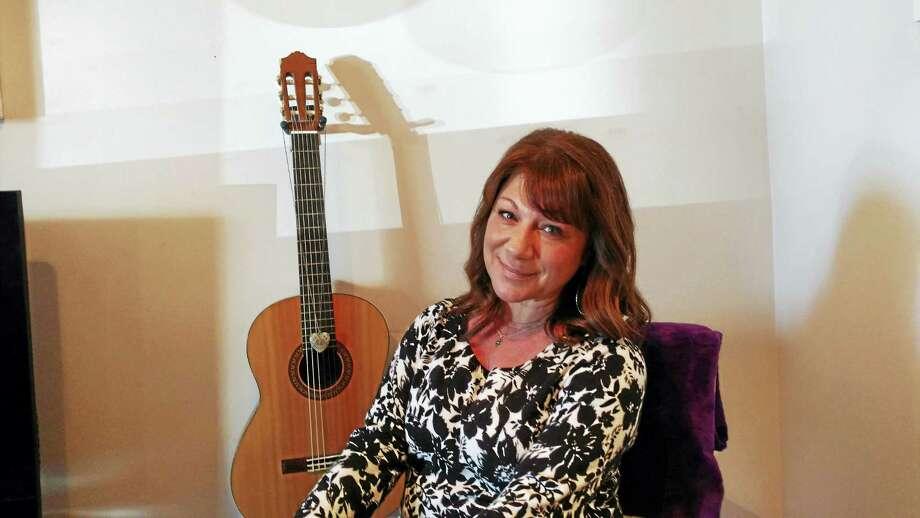 Donna Cimarelli, mother of slain high school student Maren Sanchez, is seated in front of Maren's guitar. Photo: Pam McLoughlin — New Haven Register