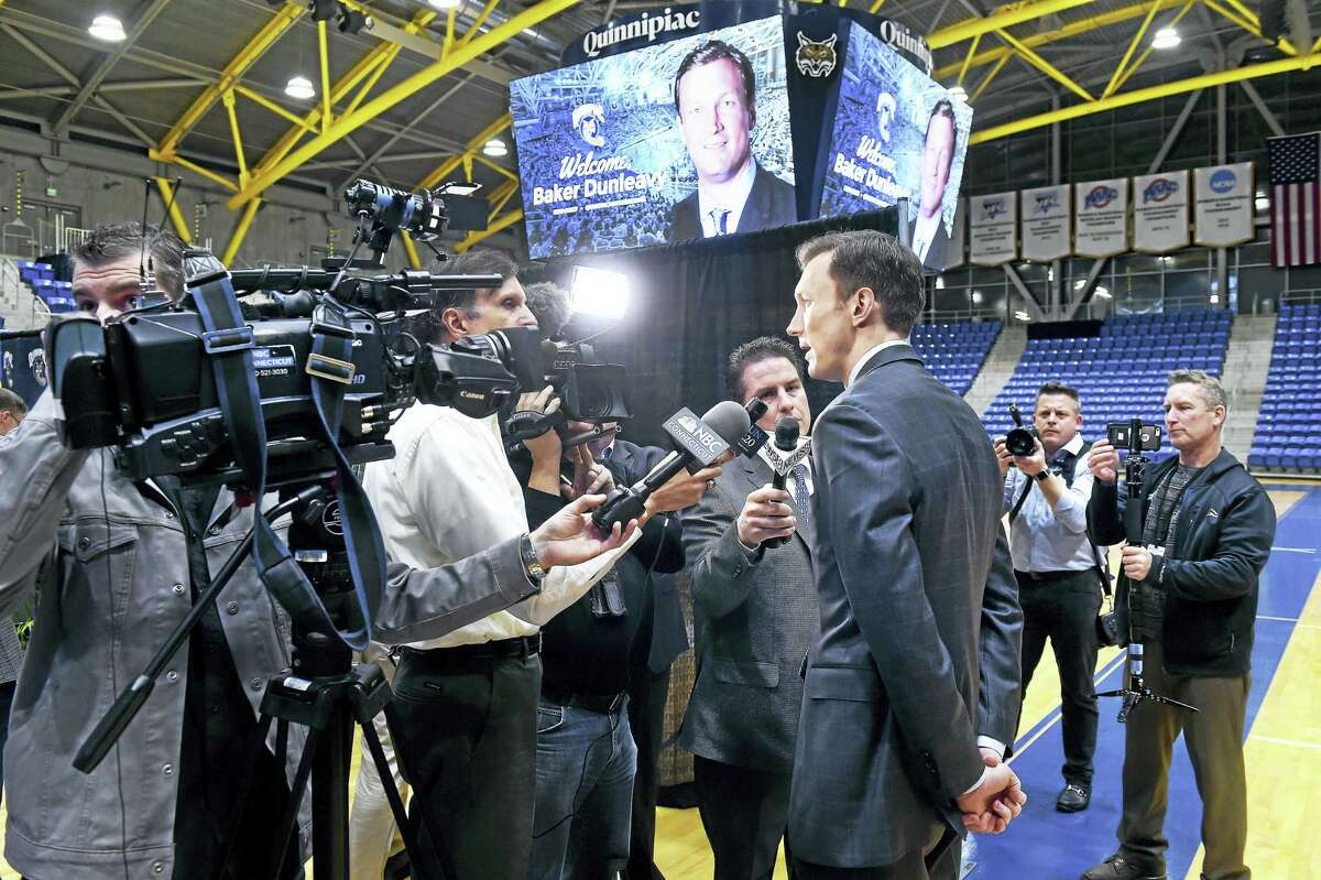 Baker Dunleavy, the new Quinnipiac men's basketball coach, is interviewed after his introduction at the TD Bank Sports Center in Hamden on Tuesday.