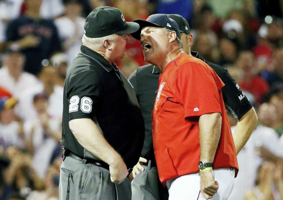 Red Sox manager John Farrell, right, argues with third base umpire Bill Miller after a called balk during the seventh inning Saturday. Photo: Michael Dwyer — The Associated Press   / Copyright 2017 The Associated Press. All rights reserved.