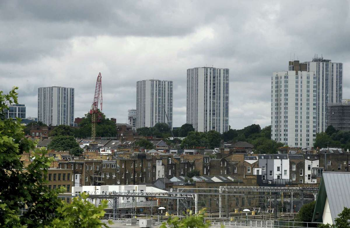 A general view of the housing towers of the Chalcots Estate in the borough of Camden, north London, Saturday June 24, 2017. Camden Borough Council said in a statement Saturday that it housed many of the residents at two temporary shelters while many others were provided hotel rooms, after inspectors found fire safety issues in housing towers, following the inferno in a west London apartment block that killed 79.