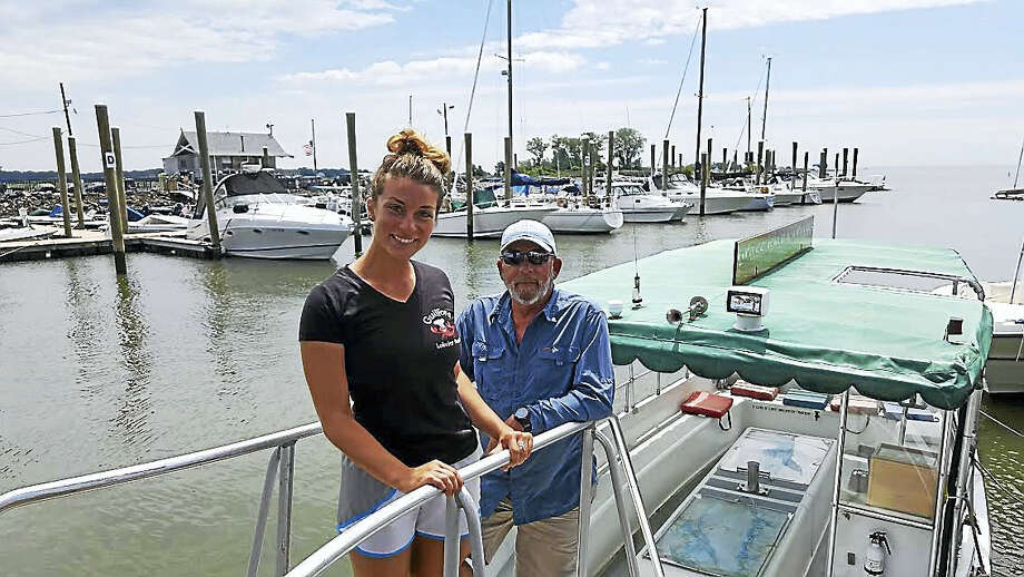 Grass Island Cruise owner and captain Bill Bussmann is photographed with Lobster Pound manager Erica Mansi in Guilford. Photo: Shahid Abdul-Karim / Hearst Connecticut Media