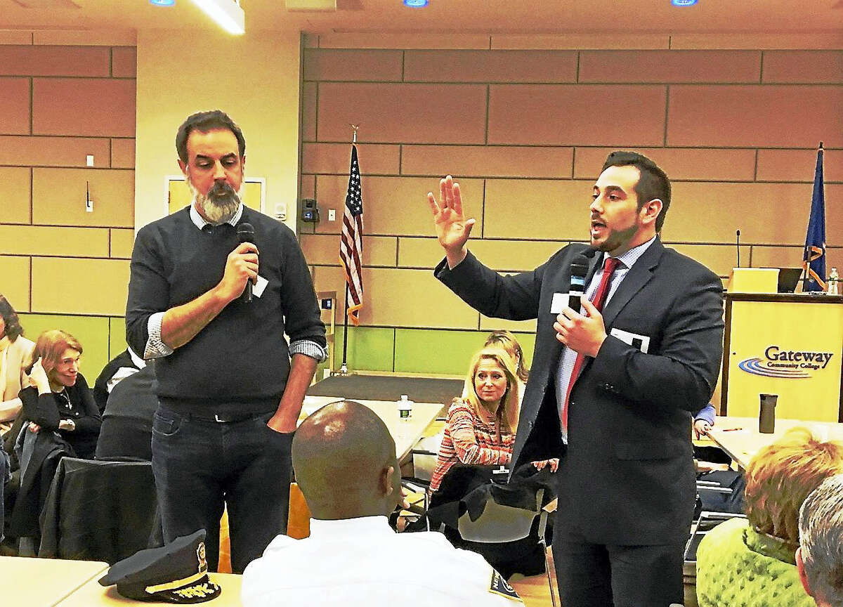 J.R. Romano, chairman of the Republican Party of Connecticut, right, speaks to crowd attending discussion on sanctuary cities at Gateway Community College Monday. John Dankosky of WNPR is at left.Mary O'Leary - New haven Register