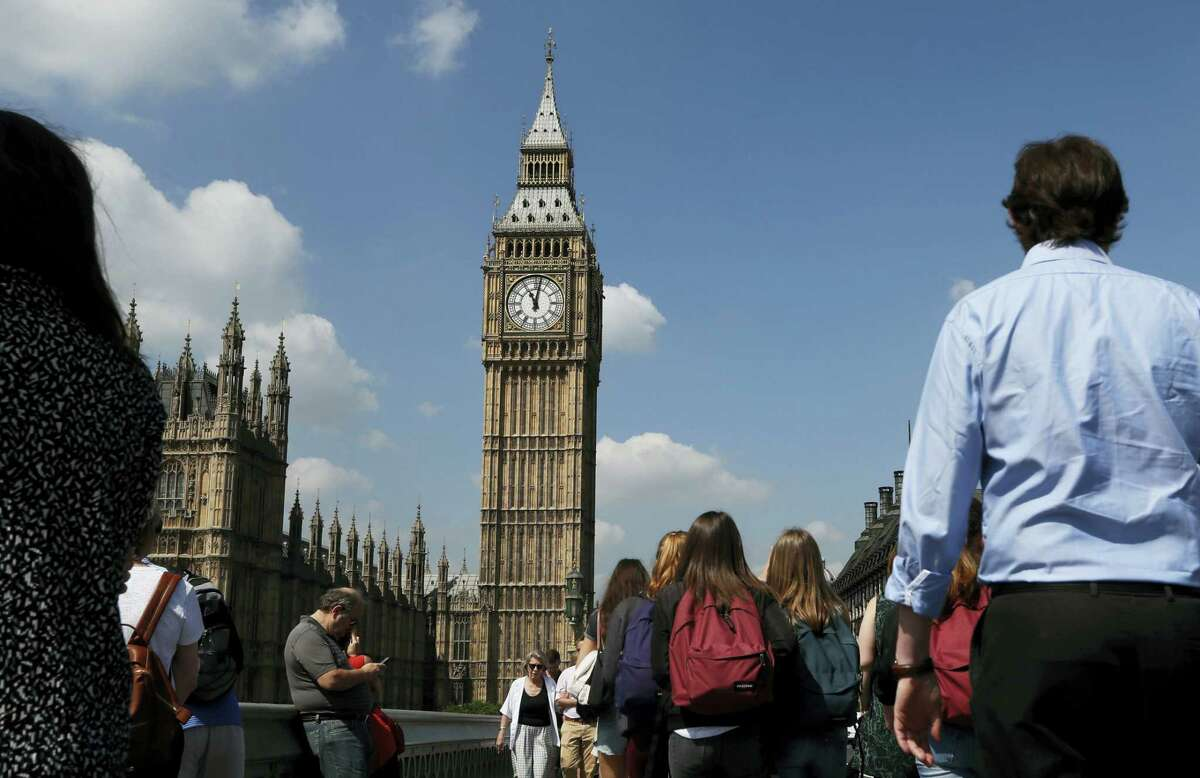 People observe a minutes silence in Westminster in London, Thursday after the suicide attack at an Ariana Grande concert that left more than 20 people dead and many more injured, as it ended on Monday night at the Manchester Arena.