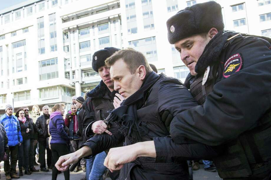 Alexei Navalny is detained by police in downtown Moscow, Russia, March 26. Photo: Evgeny Feldman For Alexey Navalny's Campaign Photo Via AP   / Evgeny Feldman for Alexey Navalny's campaign