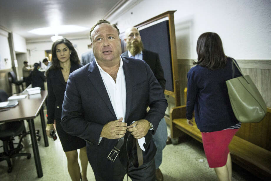 """In this Monday, April 17, 2017 photo, """"Infowars"""" host Alex Jones arrives at the Travis County Courthouse in Austin, Texas. Jones, the right-wing radio host and conspiracy theorist, is a performance artist whose true personality is nothing like his on-air persona, according to a lawyer defending the """"Infowars"""" broadcaster in a child custody battle. (Tamir Kalifa/Austin American-Statesman via AP) Photo: AP / AMERICAN-STATESMAN"""