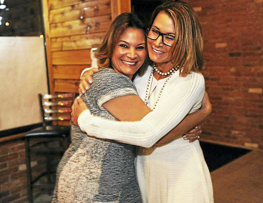 Brian A. Pounds / Hearst Connecticut Media   Republican Nicole Klarides-Ditria, left, is hugged by her sister, State House Minority Leader Themis Klarides, after winning the race for House District 105 at American Pie and Pub in Seymour on Nov. 8, 2016. Photo: Digital First Media / Connecticut Post