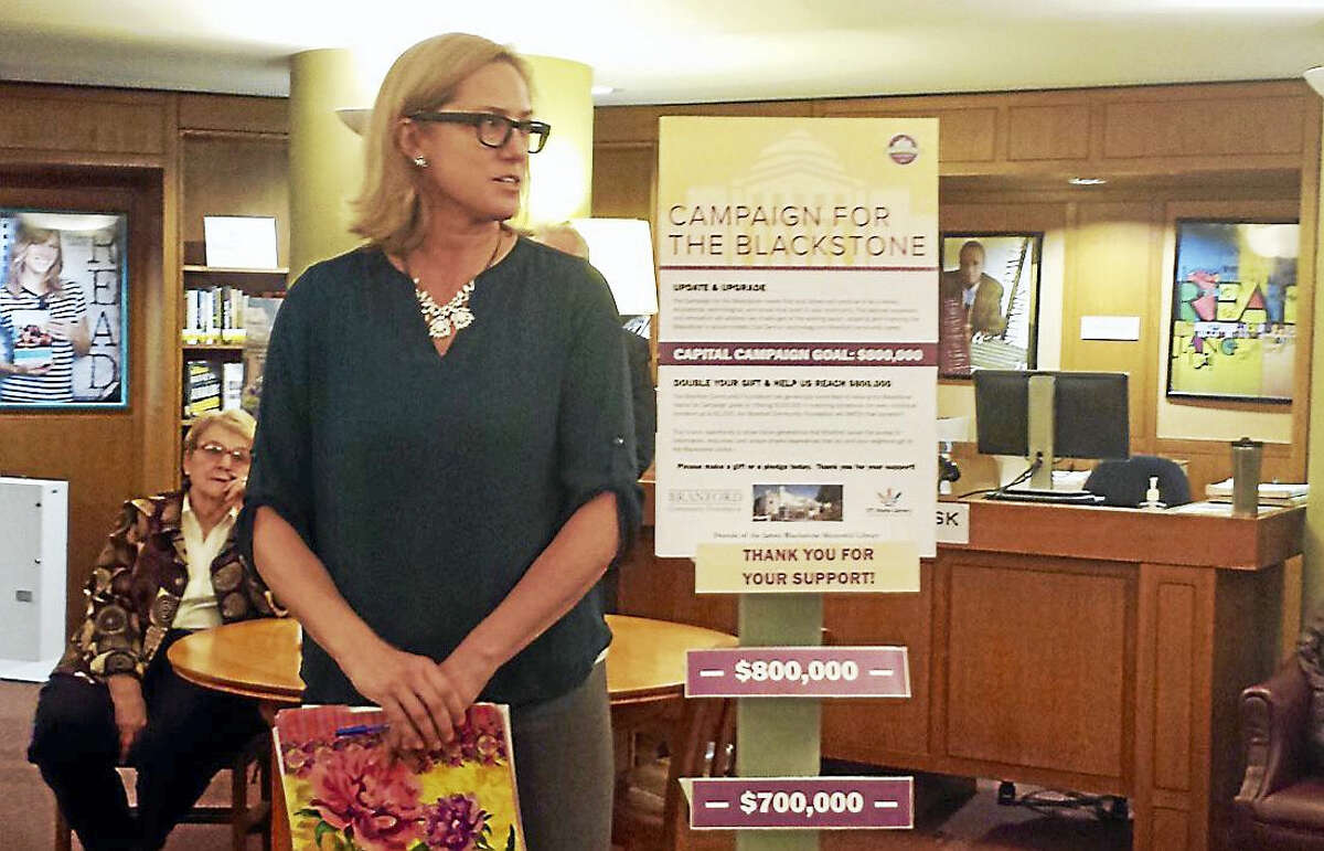 Branford Community Foundation Executive Director Liza Janssen Petra announced the nonprofit trust is pledging $100,000 to the James Blackstone Memorial Library renovation project.