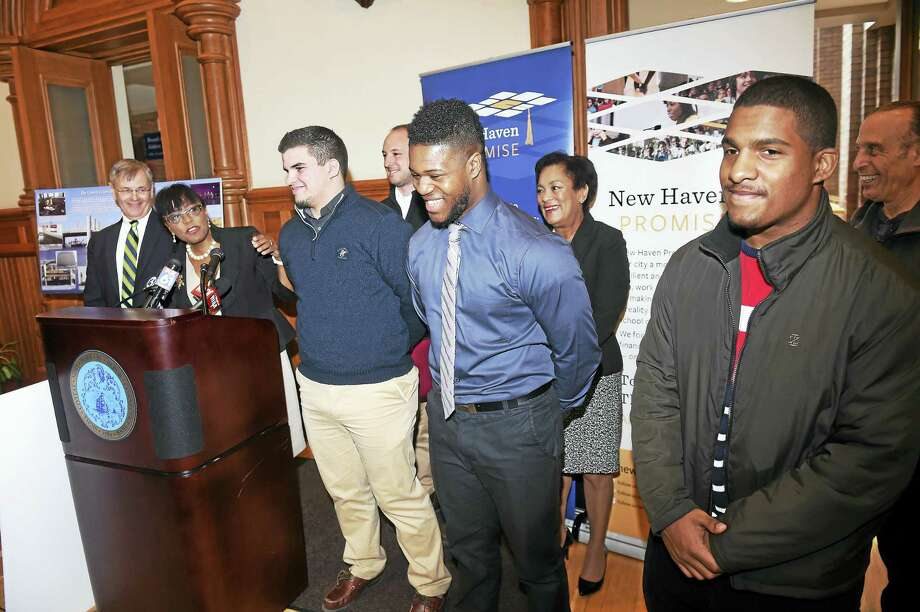 From left, State Department of Transportation Commissioner James Redeker listens to New Haven Promise Executive Director Patricia Melton honor University of New Haven mechanical engineering student Kevin Rivas, Gateway Community College manufacturing engineering student Jevaughn Brodie, and prospective mechanical engineering student Jose Sanchez of the Sound School Tuesday. Photo: Arnold Gold — New Haven Register