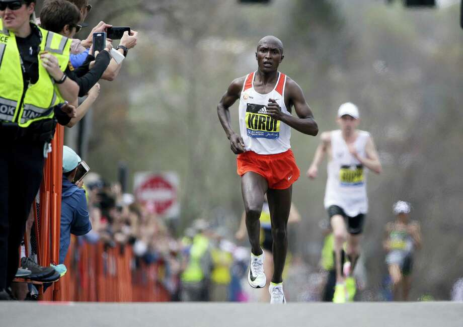 Geoffrey Kirui of Kenya leads Galen Rupp, of the United States, and the rest of the field along the course of the 121st Boston Marathon on April 17, 2017 in Brookline, Mass. Photo: AP Photo — Steven Senne   / Copyright 2017 The Associated Press. All rights reserved.