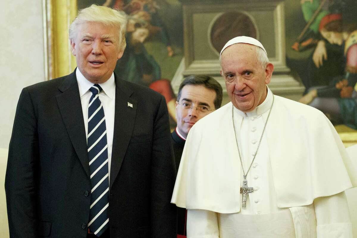 U.S. President Donald Trump stands with Pope Francis during a meeting, Wednesday, May 24, 2017, at the Vatican.